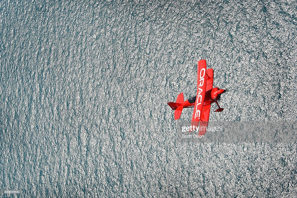 Pilot Sean Tucker flies his biplane over Lake Michigan as he prepares for this weekend's Air and Water Show August 14, 2008 in Chicago, Illinois. Sean D. Tucker is the team leader for the Collaborators formation aerobatic team.