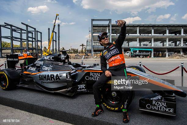 F1 pilot Sergio Checo Perez poses for pictures during a walk through the Hermanos Rodriguez Racing Circuit Facilities on January 22 2015 in Mexico...
