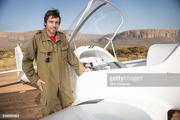 Pilot standing beside plane, Wellington, Western Cape, South Africa