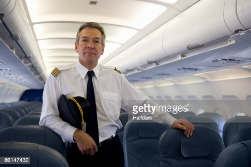 A pilot standing in the cabin of a plane
