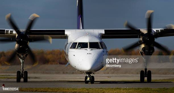 A pilot steers his aircraft along the runway at Vancouver International Airport in Richmond British Columbia Canada on Wednesday Nov 13 2013 The...