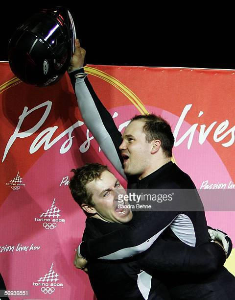 Pilot Steven Holcomb and teammate Curt Tomasevicz of United States 2 celebrate after their final run in the Four Man Bobsleigh Final on Day 15 of the...