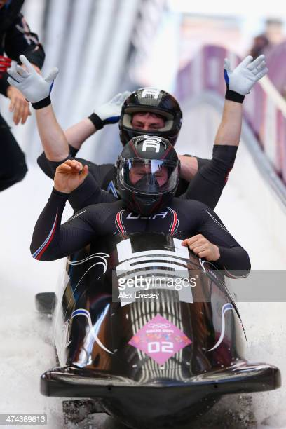 Pilot Steven Holcomb Curtis Tomasevicz Steven Langton and Christopher Fogt of the United States team 1 finish a run during the Men's FourMan...