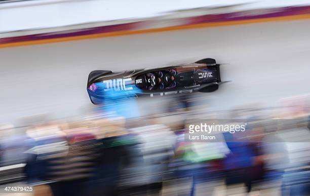 Pilot Steven Holcomb Curtis Tomasevicz Steven Langton and Christopher Fogt of the United States team 1 make a run during the Men's Four Man Bobsleigh...