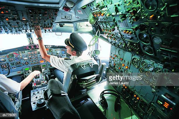Pilot Switching a Control in the Cockpit of a Commercial Aeroplane