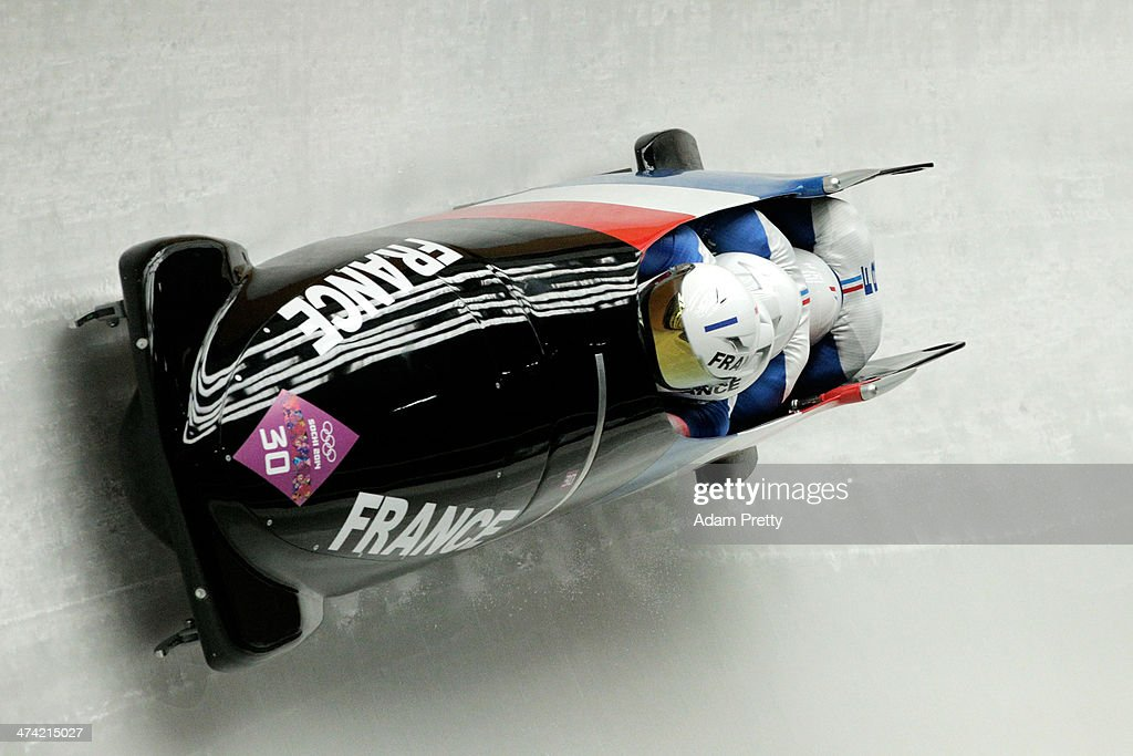 Pilot Thibault Alexis Godefroy, Jeremy Baillard, Vincent Daniel Jean-Paul Ricard and Jeremie Boutherin of France team 2 make a run during the Men's Four Man Bobsleigh heats on Day 15 of the Sochi 2014 Winter Olympics at Sliding Center Sanki on February 22, 2014 in Sochi, Russia.