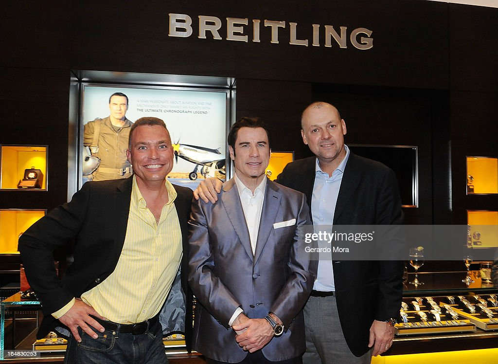 Pilot Thom Richards (L), actor <a gi-track='captionPersonalityLinkClicked' href=/galleries/search?phrase=John+Travolta&family=editorial&specificpeople=178204 ng-click='$event.stopPropagation()'>John Travolta</a> (C) and Thierry Prissert, Breitling USA President, pose during the Breiting Boutique Orlando Grand Opening Event on March 28, 2013 in Orlando, Florida.
