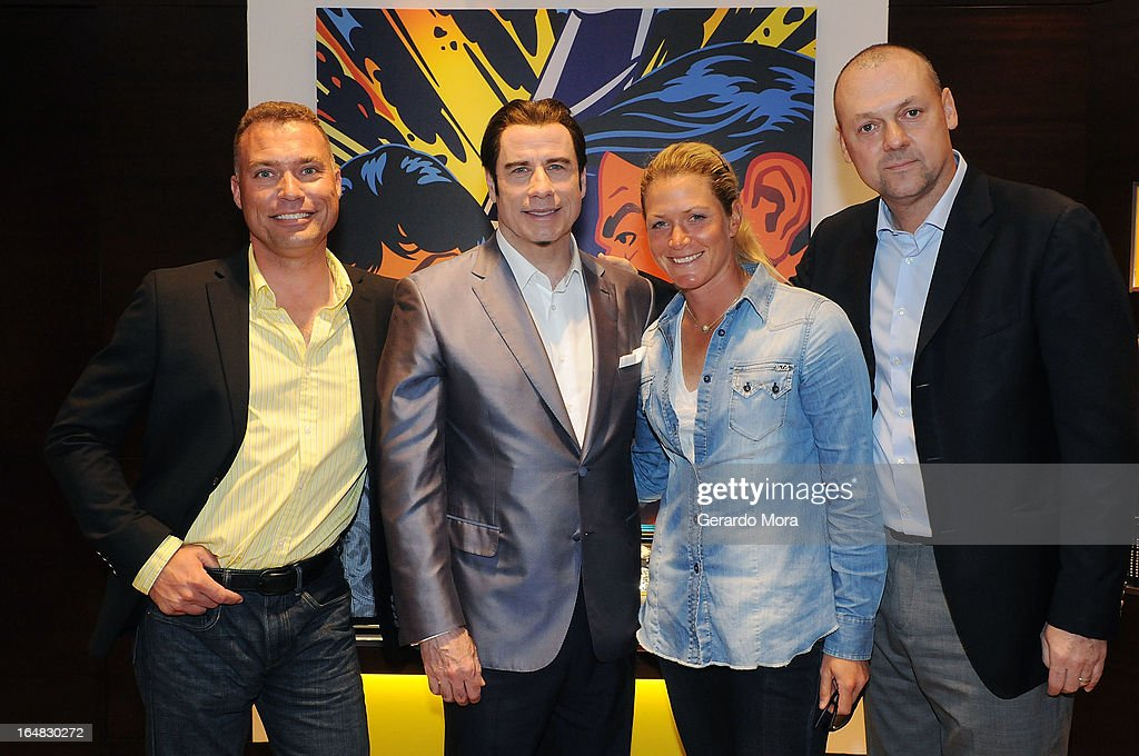 Pilot Thom Richards, actor <a gi-track='captionPersonalityLinkClicked' href=/galleries/search?phrase=John+Travolta&family=editorial&specificpeople=178204 ng-click='$event.stopPropagation()'>John Travolta</a>, golf player <a gi-track='captionPersonalityLinkClicked' href=/galleries/search?phrase=Suzann+Pettersen&family=editorial&specificpeople=218091 ng-click='$event.stopPropagation()'>Suzann Pettersen</a> and Thierry Prissert, Breitling USA President, pose during the Breiting Boutique Orlando Grand Opening Event on March 28, 2013 in Orlando, Florida.