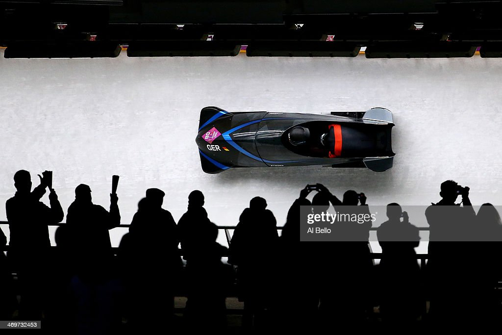 Pilot Thomas Florschuetz and <a gi-track='captionPersonalityLinkClicked' href=/galleries/search?phrase=Kevin+Kuske&family=editorial&specificpeople=780181 ng-click='$event.stopPropagation()'>Kevin Kuske</a> of Germany team 2 make a run during the Men's Two-Man Bobsleigh heats on Day 9 of the Sochi 2014 Winter Olympics at Sliding Center Sanki on February 16, 2014 in Sochi, Russia.