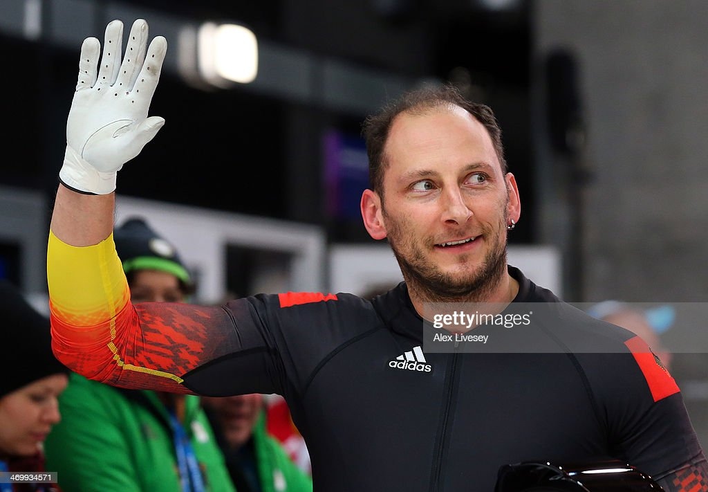 pilot Thomas Florschuetz of Germany team 2 waves to the crowd during the Men's Two-Man Bobsleigh on Day 10 of the Sochi 2014 Winter Olympics at Sliding Center Sanki on February 17, 2014 in Sochi, Russia.