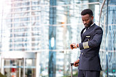 Afro American Pilot, Airport, Looking, Watch, Uniform, Luggage