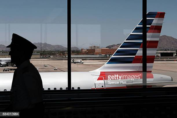 A pilot walks through the Phoenix airport on May 24 2016 in Phoenix Arizona The Transportation Security Administration has come under renewed...