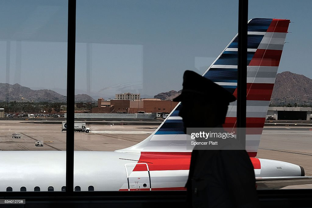 A pilot walks through the Phoenix airport on May 24, 2016 in Phoenix, Arizona. The Transportation Security Administration (TSA) has come under renewed criticism from government officials and the general public following an escalation of wait times at security screenings at domestic airports as the summer travel season begins. Kelly Hoggan, the Transportation Security Administration's head of security operations, has been put on paid administrative leave pending reassignment.