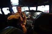 Pilot Wayne Ringelberg poses in the cockpit of NASA's highly modified Douglas DC8 jetliner which operates as a flying science laboratory as it is...