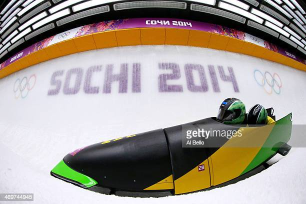 Pilot Winston Watts and Marvin Dixon of Jamaica team 1 make a run during the Men's TwoMan Bobsleigh heats on Day 9 of the Sochi 2014 Winter Olympics...