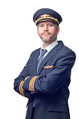 Pilot in uniform standing with arms crossed isolated on white