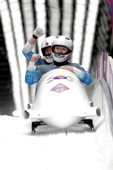 Pilot Yunjong Won and Youngwoo Seo of Korea team 1 celebrate after a run during the Men's TwoMan Bobsleigh on Day 10 of the Sochi 2014 Winter...