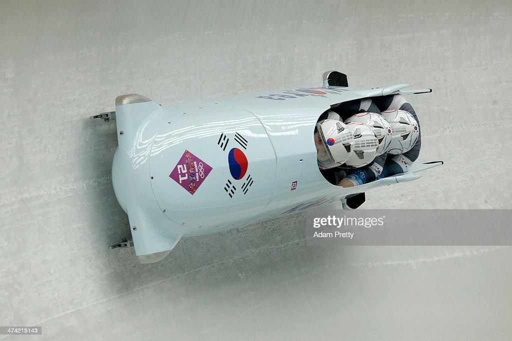 Pilot Yunjong Won, Youngjin Suk, Junglin Jun and Youngwoo Seo of Korea team 1 make a run during the Men's Four Man Bobsleigh heats on Day 15 of the Sochi 2014 Winter Olympics at Sliding Center Sanki on February 22, 2014 in Sochi, Russia.