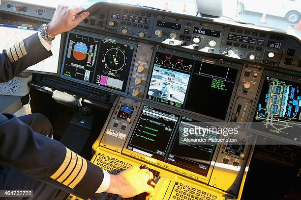 A pilote on the flight deck in the new Airbus A350X WB passenger plane as he stands on the tarmac at Munich Airport during a presentation of the new...