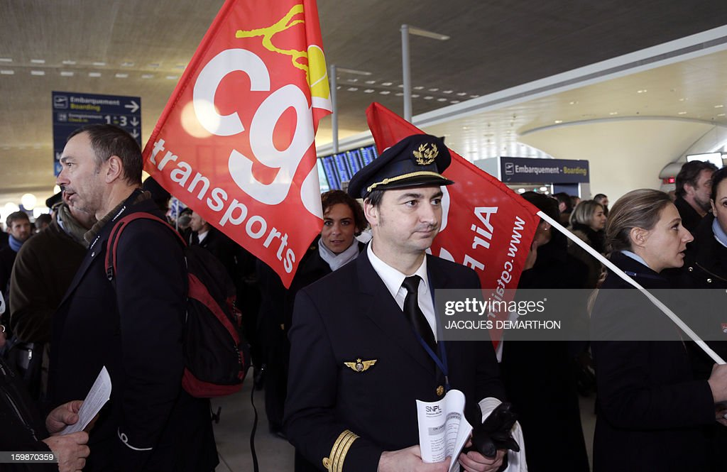 Pilots and cabin crew members of European airline companies take part in a demonstration, on January 22, 2013 at Roissy Charles-de-Gaulle airport, in Roissy-en-France outside Paris, as part of a strike of European pilots.