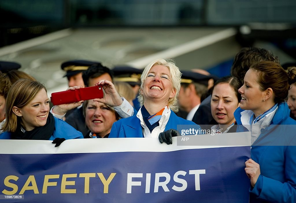 Pilots and cabin crew members of several airline companies take part in a demonstration on January 22, 2013 at Schiphol airport, in Amsterdam, The Netherlands, as part of a strike of European pilots. AFP PHOTO / BELGA - ROBIN VAN LONKHUIJSEN = netherlands out