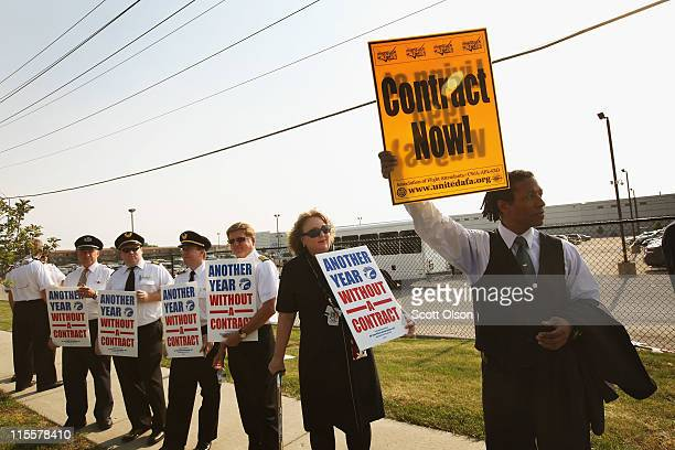 Pilots and crew members from United and Continental Airlines participate in informational picketing during the annual shareholders meeting for United...