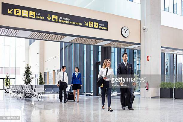 Pilots and flight attendants walking at the airport