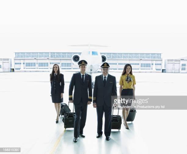 Pilots and flight staff on tarmac