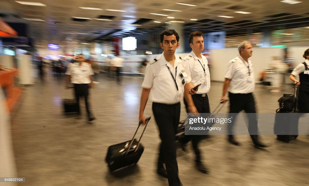 Pilots are seen at the Ataturk International Airport after the air traffic returned to normal following yesterday's terror attack in Istanbul, Turkey on June 29, 2016. At least 36 victims and three suicide bombers were killed while scores of others were injured in a terror attack on Istanbuls Ataturk International Airport.
