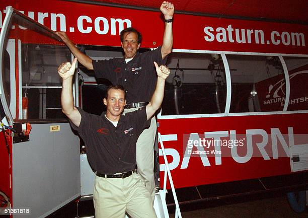 Pilots Carl Harbuck and Douglas McFadden celebrate the Saturn Relay Lightship's record breaking flight