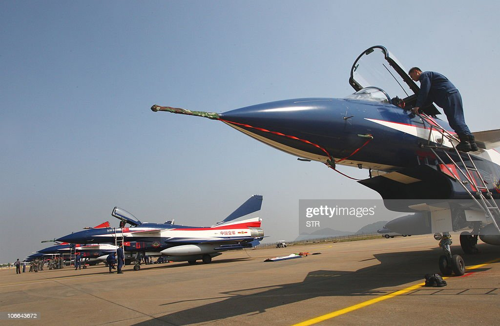 Pilots check a group of seven Chinesemade Jian10 fighter jets which will put on a show of aerial stunts during the Air Show 2010 in Zhuhai south...
