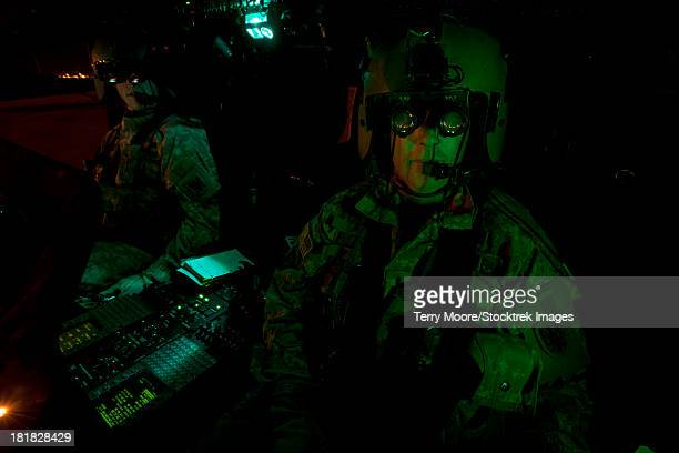 Pilots equipped with night vision goggles in the cockpit of a UH-60 Black Hawk helicopter at Davis Monthan Air Force Base, Arizona.