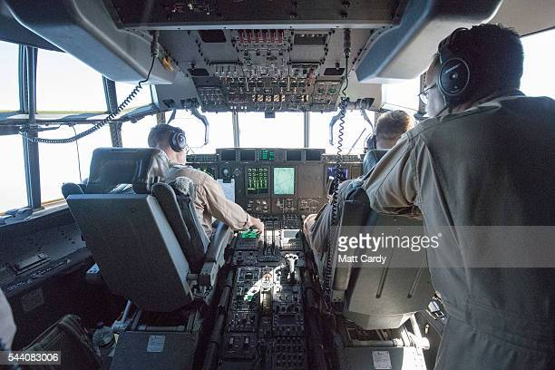 Pilots fly a KC130J Super Hercules aircraft to refuel the first of Britain's F35B Lightning II jets as they fly over the North Sea having taken off...