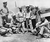 Pilots from the allblack fighter squadron share stories after a raid The pilots are Lt Herbert Clark Lt Robert Roberts Lt Willie Fuller Lt William...