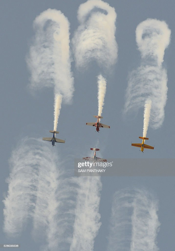 Pilots from the Global Stars Aerobatic Team participate on the first day of a three-day air show in the Indian city of Ahmedabad on April 29, 2016. Four British planes are taking part in the event, which ends on May 1. / AFP / SAM