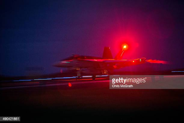 Pilots in a F/A18E Super Hornet complete a night time touchandgo landing during Field Carrier Landing Practice for the Carrier Air Wing 5 of US Naval...