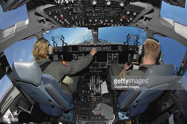 Pilots in the cockpit of a C-17 Globemaster.