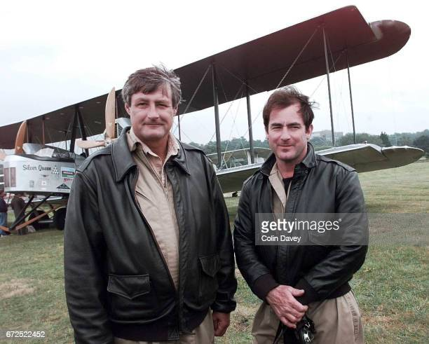 Pilots Mark Rebholz and John LaNoue stand in front of a replica of a 1918 Vickers Vimy aircraft being tested at Brooklands Airfield United Kingdom...