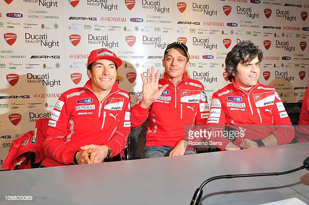 Pilots Nicky Hayden and Valentino Rossi and project manager of Ducati motorbikes Filippo Preziosi attends the press conference before the ceremony to...
