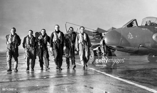 Pilots of 3613 Fighter Control Unit of the Royal Auxiliary Air Force make their way to the briefing room to report on their mission at Bowlee 11th...