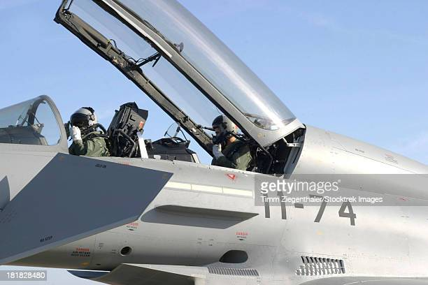 Pilots perform preflight checks in the cockpit of a Spanish Air Force Eurofighter Typhoon, Moron, Spain.