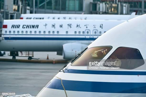 Pilots preparing Air China Boeing 787 for departure