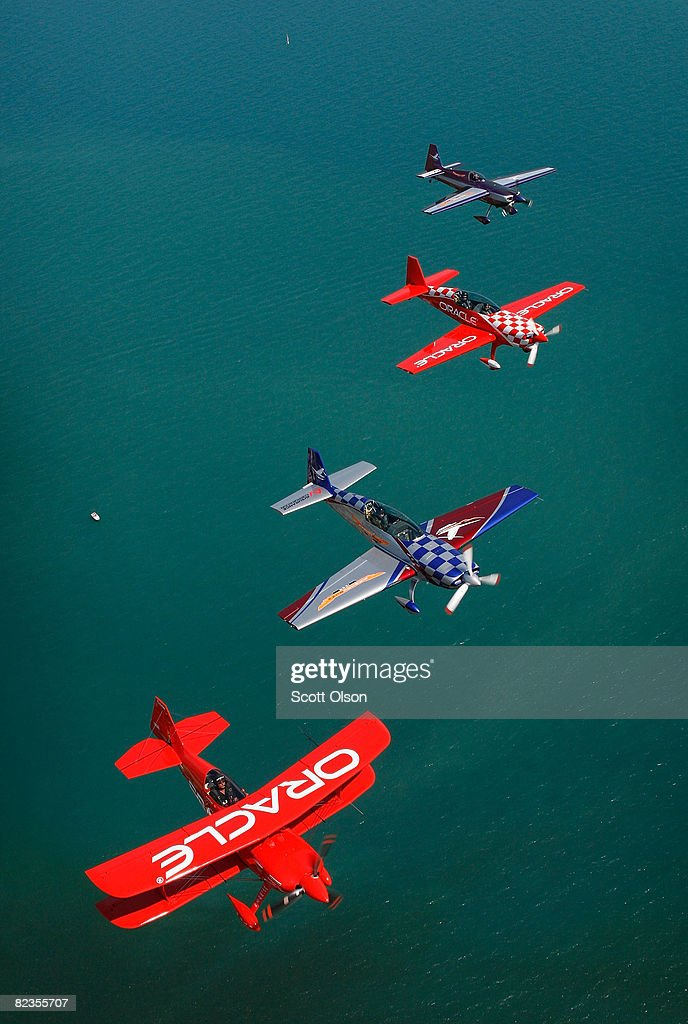Pilots Sean Tucker (bottom), his son Eric (second from top), Bill Stein (top) and Ben Freelove fly their aircraft over Lake Michigan as they prepare for this weekend's Chicago Air and Water Show August 14, 2008 in Chicago, Illinois. The team of flight instructors from the Tutima Academy of Aviation Safety will perform as the Collaborators formation aerobatic team during the show.