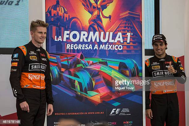 F1 pilots Sergio Perez and teammate Niko Hulkenberg pose for pictures during a walk through the Hermanos Rodriguez Racing Circuit Facilities on...
