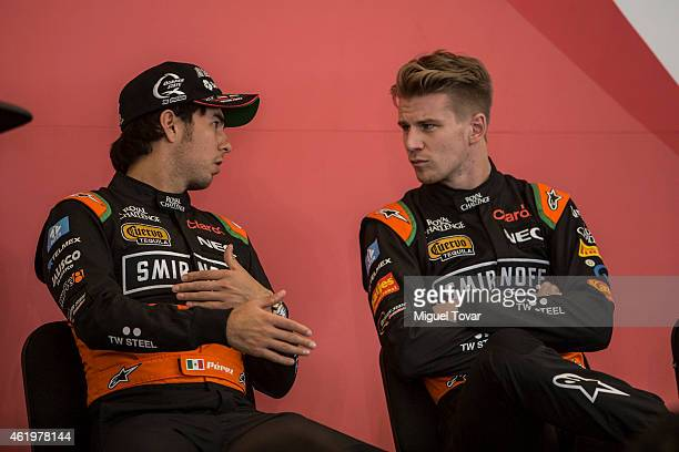 F1 pilots Sergio Perez and teammate Niko Hulkenberg talks during a press conference at the Hermanos Rodriguez Racing Circuit Facilities on January 22...