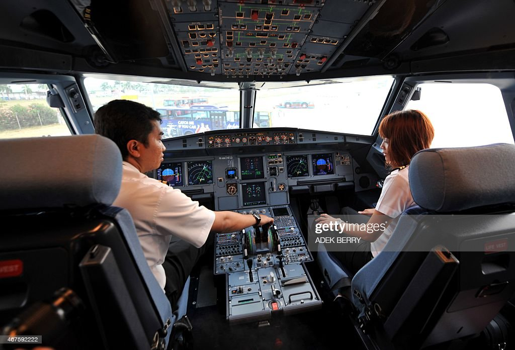 Pilots show the cockpit of the new Asia Air's Airbus A320 at Cengkareng airport in Jakarta on September 24 2008 The first Air Bus A320 had landed in...