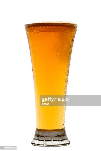 Pilsner Beer glass in centre of frame