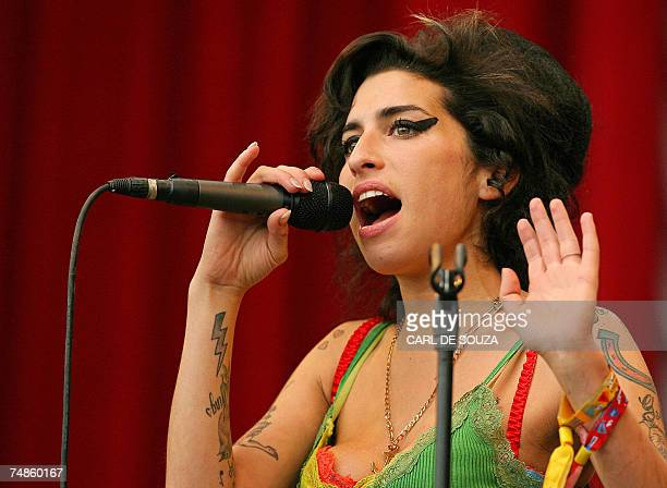 British pop singer Amy Winehouse performs at the Glastonbury music festival in Pilton Somerset in southwest England 22 June 2007 The Glastonbury...