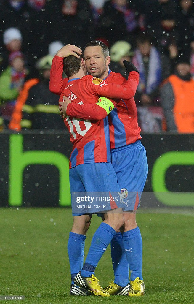 Pilzen's midfielder Pavel Horvath (R) and Pilzen's midfielder Vladimir Darida celebrate after the UEFA Europa League Round of 32 football match FC Viktoria Plzen vs SSC Napoli in Plzen, Czech Republic on February 21, 2013. Plzen won the match 2-0.