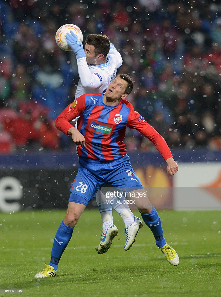 Pilzen's Slovenian defender Marian Cisovsky (front) vies for the ball with Napoli's forward Emanuele Calaio during the UEFA Europa League Round of 32 football match FC Viktoria Plzen vs SSC Napoli in Plzen, Czech Republic on February 21, 2013.
